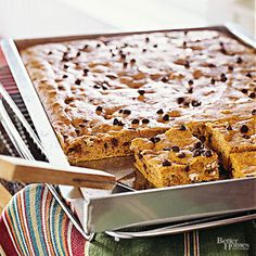 A schmear of cream cheese frosting tops this classic pumpkin bar recipe to complete the indulgent dessert recipe. Top each serving of the bar recipe with a pecan half for a special touch.