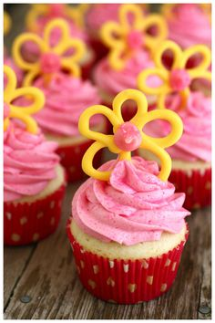 Pink cupcakes with yellow flowers as you can see.... DELISH : )