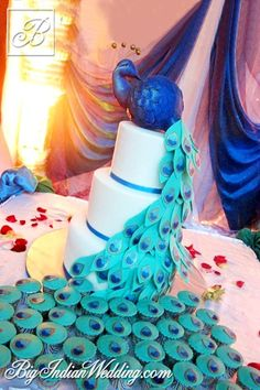 Cakes and Cupcakes peacock-themed wedding cake and cupcakes