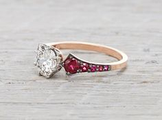 Only $12,900 This ring as shown is made of 18k rose gold, platinum and black rhodium and centered with a 1.03 carat GIA certified old european cut diamond with I color and SI1 clarity. Accented with .42 carats of rubies.