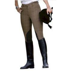 Bruin geblokte rijbroek met kniestukken van het merk Pfiff. De broek heeft kunstlederen kniestukken en een zakje aan de voorkant die met een rits gesloten wordt. De broek zit comfortabel en elastisch, het materiaal bestaat uit 95% katoen en 5% elasthan. Kleur: bruin/zwart
