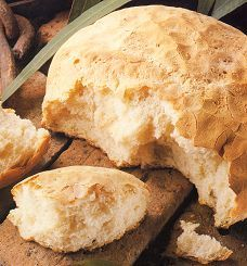 Damper: In colonial Australia, stockmen developed the technique of making damper out of necessity. Often away from home for weeks, with just a camp fire to cook on and only sacks of flour as provisions, a basic staple bread evolved. It was originally made with flour and water and a good pinch of salt, kneaded, shaped into a round, and baked in the ashes of the campfire or open fireplace.