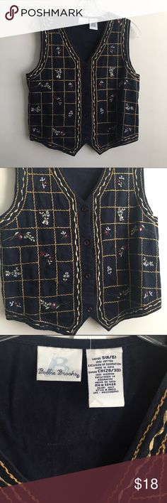 Bobbie Brooks Vintage Navy Blue Floral Vest Cute Bobbie Brooks vintage button up Floral vest in perfect condition. Size small. 100% cotton. Machine washable. 38 inch waist with tie back, 32 inch bust, 23 inch length Jackets & Coats Vests