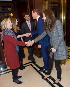 Kate Middleton and Prince William meet Hillary and Chelsea Clinton during a conservation reception at British Consul General's Residence on Dec. 8, 2014 in New York.