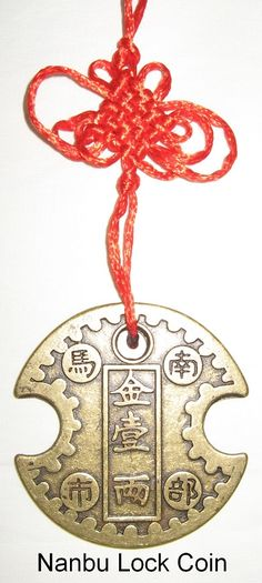 Nanbu Lock Coin - Feng Shui Money Hanger. The Nanbu Lock Coin will help you improve your investment luck in new businesses, stocks, real estate, retirement funds, 401K, lottery tickets, gambling and other risks. Optimize your chances of having successful investments. http://www.yourfengshuistore.com/Nanbu-Lock-Coin_p_55.html