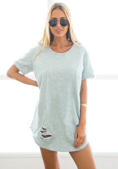 What's New // The grunge yet flirty appeal of this grey crew-neck ripped tunic makes it a worthy addition to your wardrobe.