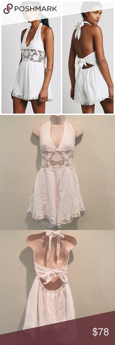 NWOT Free People white Day Dream Romper Brand new without tags. Crinkly gauzey lightweight romper featuring crochet detailing along the waist and hem. Plunging V-neck with a halter tie. Low back with tie and an elastic band for an easy fit. Lined. 100% Cotton. Hand Wash Cold. Import. See photo for crossed out tag to prevent return to retail store. Free People Pants Jumpsuits & Rompers