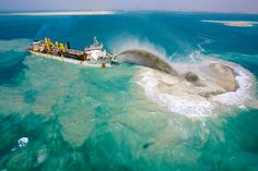 dredging ship creating the Palm Islands