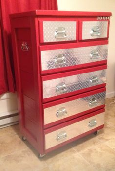 This is a dresser that I got from auction and repurposed and made it look like a toolbox for the grandson