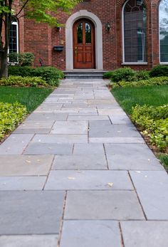 Like this style of walkway coming off the steps and edging the driveway and going around the right side of house. Is stamped concrete cheaper?