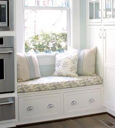 Kitchen window seat with storage below. by andrea@jardin