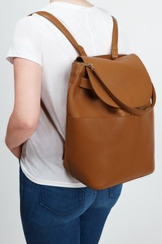 """The backpack you've been waiting for. Crafted in Italy from beautifully soft Italian leather, our rendition of the essential carryall considers every little detail. Complete with a detachable top shoulder strap, lightly padded back straps, and even space to fit a 13"""" laptop, this piece is a refined blend of style and substance. It will act effortlessly as a chic day-to-night bag."""
