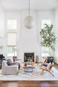 my scandinavian home: A sitting room with dramatically high ceilings in a beautiful, Spanish style house in California #sittingroom #fireplace #livingroom