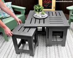 Easy DIY outdoor coffee table plan with 4 hidden side tables - the side tables easily pull out for more storage