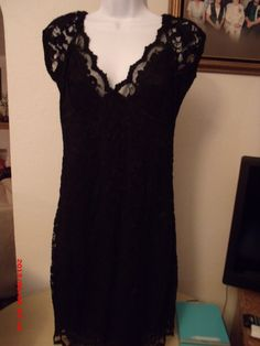 Black lace dress with black underlay. Starting at $5 on Tophatter.com!