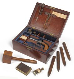 A box from the 1890s containing equipment to kill a vampire. Belief in the existence of vampires persisted throughout the 19th century and the study of vampirism increased in popularity after the publication of Bram Stoker's novel 'Dracula' in 1897. This kit contains various items to slay the undead including: a rosary, crucifix, pistol, silver bullet mold, a hammer and 4 stakes, a copy of the Bible, three glass bottles containing holy water, consecrated earth and garlic paste