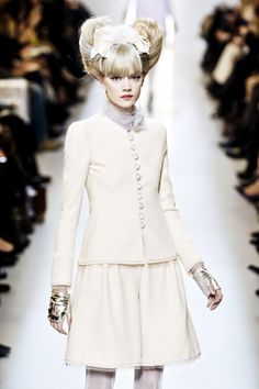 18. Chanel ; Modern Day Tailor-Mades suit; jacket matches skirt and top placed underneath