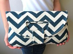 Clutch or tote? Blue and white chevron!? I'd buy it right away, but then there would be no money to carry inside the purse :-(