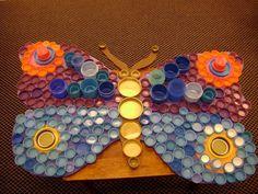 mariposa con tapas plásticas