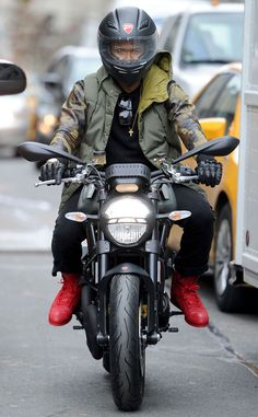 Usher from Sexy Male Celebs on Motorcycles  Check out the R&B star and The Voice newbie on this Ducati Monster in New York.