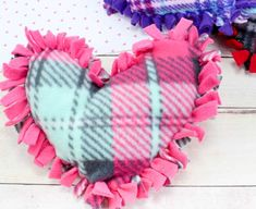 These valentine pillows are so easy to make! They use the classic summer camp fleece tie pillows method and are the perfect Valentine's Day crafts for tweens and big kids. Valentine Crafts For Kids, Crafts For Kids To Make, Valentine Day Crafts, Crafts For Teens, Teen Crafts, Holiday Crafts, Summer Camp Crafts, Camping Crafts, Tween Gifts