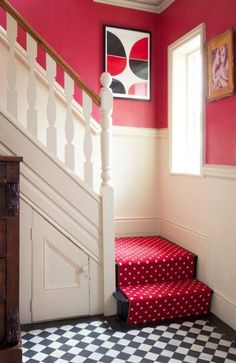 Love the graphic tiled floor mixed with the polka dot runner on the stairs…and that gorgeous shade of red on the walls.  This is at once super-co-ordinated but homey and casual and it screams Happy!