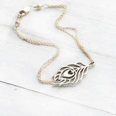 Gold peacock feather bracelet
