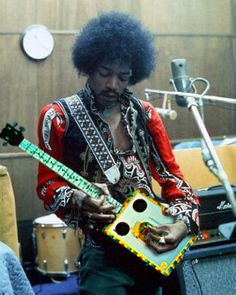 Jimi playing a Cigar Box- when I was with 10 -we were in the entourage with Jimi at the Hollywood rockfest- his beautiful sad eyes are always with me.