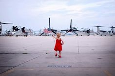This is my daughter, at a little over 2 years old, welcoming her daddy home from a 7 month deployment to Afghanistan. (military wife)