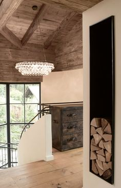 Love the firewood storage The design team at Bernd Gruber was hired to overhaul this traditionally styled chalet in Kitzbuhel, a small medieval town in Tyrol, Austria. It was the client's wish that the character of the home was to be preserved as much as possible, while updating it to enjoy modern amenities and to add more natural light. …