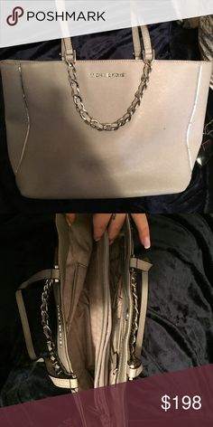 Michael Kors handbag. Gorgeous gray Michael Kors handbag! Absolutely love this bag, but I have a shopping problem and have way too many! Would love to see someone get great use out of this bag! Just has a little black spot on the front otherwise has no signs of wear. Michael Kors Bags Shoulder Bags
