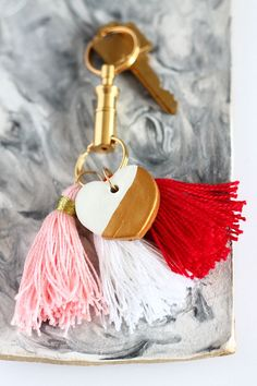 Make an air dry clay heart, dip it in gold paint and make some tassels to create this cute keychain | Squirrelly Minds