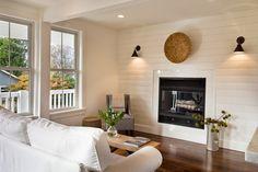 Craftsman trim, modern plank wall, sconces
