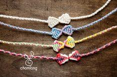 こんにちは!今日はこんなかわいいリボンのヘンプブレスの作り方です!長くすると... Macrame Bracelet Patterns, Macrame Bracelets, Handmade Crafts, Diy And Crafts, Crochet Thread Patterns, Dorset Buttons, Handmade Accessories, Friendship Bracelets, Crochet Necklace