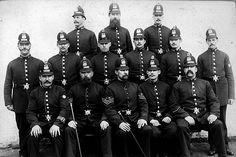 A group of Manchester City Police officers from the 1880's. By this time the uniform had changed from the top hat and white trousers of the early Peelers to a style of uniform that was to remain familiar for decades. The basic design of the helmet is still recognisable and much of the rank insignia is still in use today. From the collection of the Greater Manchester Police Museum and Archives.