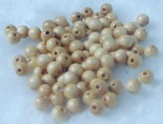 100 pcs-4mm polished wooden beads.. €1.49, via Etsy.