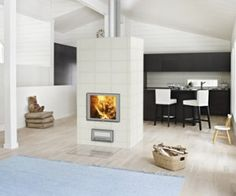 See-through fireplace Henna divides the kitchen from the livingroom. The unit is fits nicely in a modern home.