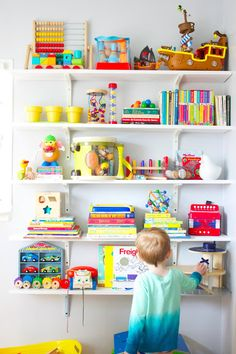 Toy shelves only hang half instead of to the top of the wall for easier access.