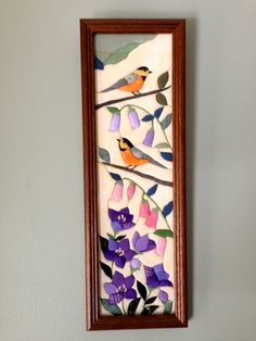 Birds and flowers made from cloth.
