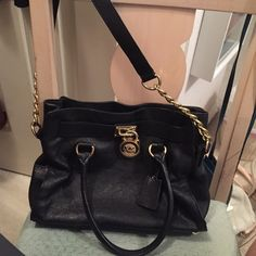 Michael Michael Kors black leather crossbody Gorgeous Michael Kors black leather medium sized handbag, comes with gold chain strap, so you can wear it as a crossbody or over your shoulder. In great condition! MICHAEL Michael Kors Bags Shoulder Bags
