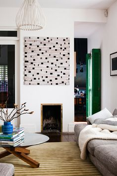 big painting, small fireplace