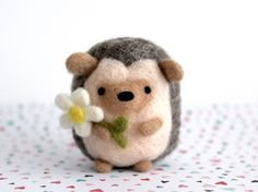 ~Made to Order~  This adorable needle felted hedgehog holding a daisy is handmade with love out of 100% natural wool. This wooly woodland