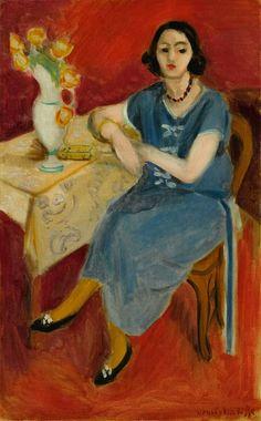 Henri Matisse – Femme en bleu à table. Fond rouge, 1923