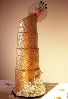 Charm City Cakes 2012. Love the unexpected ruffles at the bottom of this one and the golden mosaic looks like something from Gustav Klimt.
