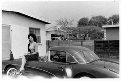 Woman sitting on a 1959 Corvette