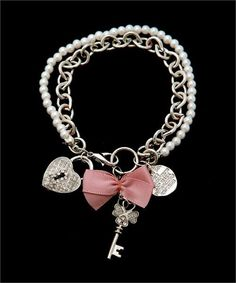 A personal favorite from my Etsy shop https://www.etsy.com/listing/255877875/rhodium-locket-key-silver-charm-bracelet