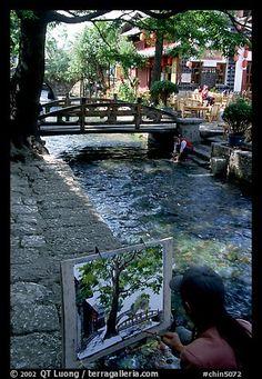 **Painting a bridge. Lijiang, Yunnan, China