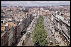 A grand view of Dublin, Ireland from Nelsons Pillar in 1956. See the green double decker busses, the church spires, the savoy hotel and other historical landmarks in this wonderfullly clear print. This 8x12 print is great for people with ties to the area! The street looks very different today. You can still get a view from above OConnell Street, but not from Nelsons Pillar which was destroyed by a terrorist bomb in 1966. The Spire of Dublin is the replacement. This is an original picture…