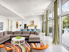 Someday I want to incorporate this Paul Smith swirl rug into our house... modern living room by Baxter Design Group