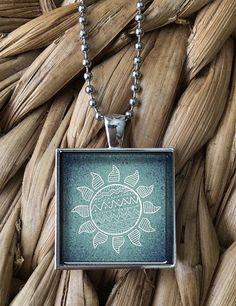 Stylized Blue Sun Pendant Necklace by MoonPoppyDesigns on Etsy